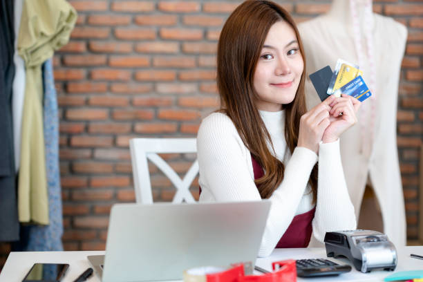 Young Asian small business owner working at home office, video calling on purchase orders. Online marketing packaging delivery, startup SME entrepreneur or freelance woman concept