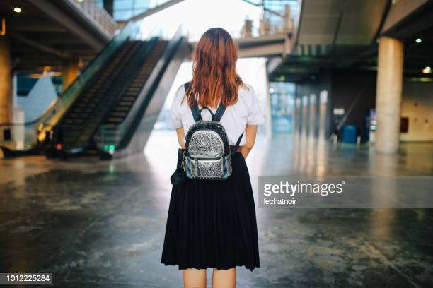 young asian student in uniform arriving at school or university - schoolgirl stock pictures, royalty-free photos & images