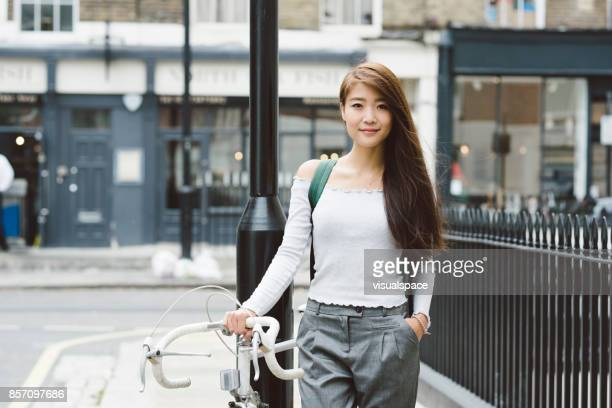 Young Asian Student with Bicycle in London