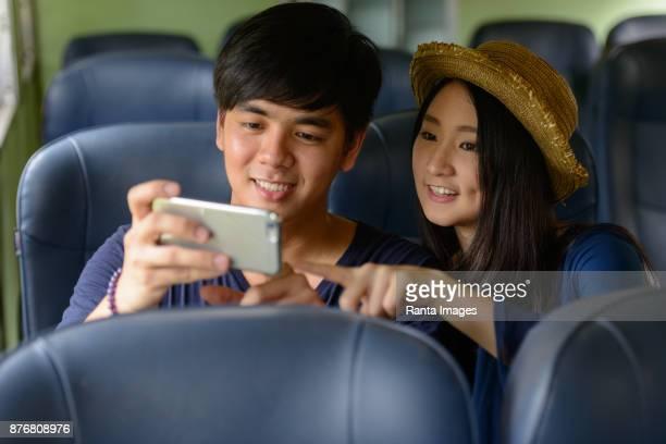 Young Asian tourist couple together at Hua Lamphong railway station in Bangkok Thailand