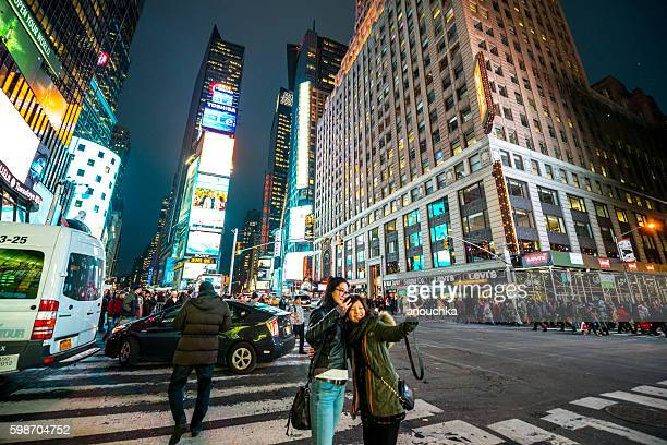 Young asian tourists making selfie in New York, USA