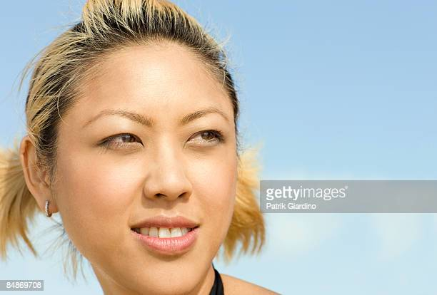 Young Asian Woman against sky
