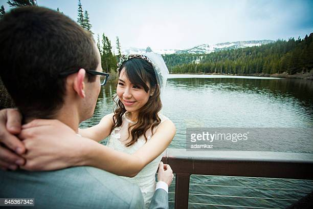 Young Asian Woman and Caucasian Man Wedding Photo