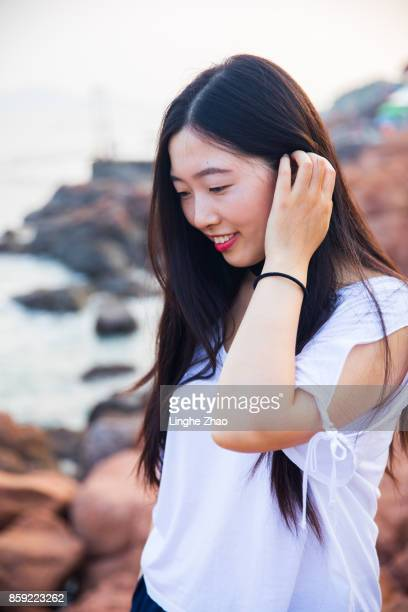 Young asian woman at coastline