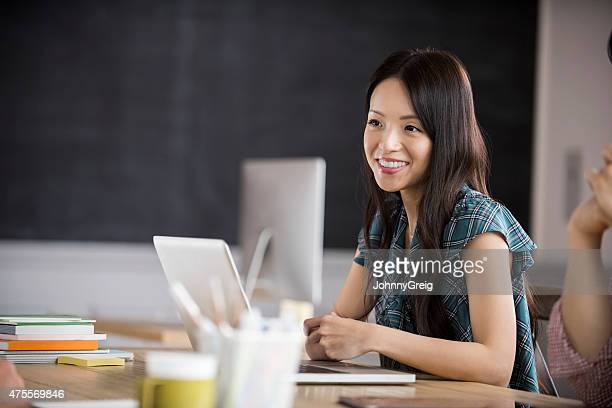 Young Asian woman at work.