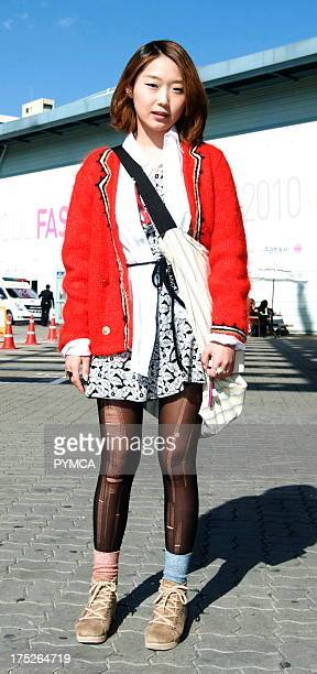 A young Asian woman attending Seoul Fashion Week S/S 2010