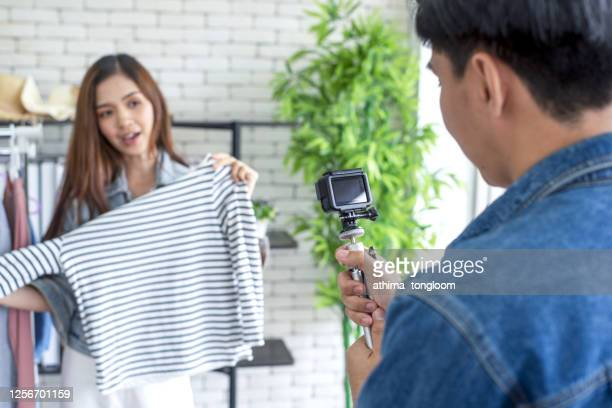young asian woman blogger broadcasting live online via social media. - live broadcast stock pictures, royalty-free photos & images