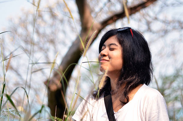 Young asian woman breathing fresh air