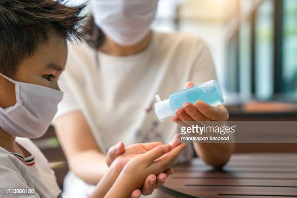 young asian woman coronavirus sanitizer alcohol gel clean hand protection infection virus bacteria cleanser - antiseptic stock pictures, royalty-free photos & images