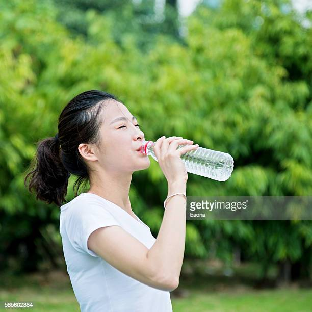 Young asian woman drink water