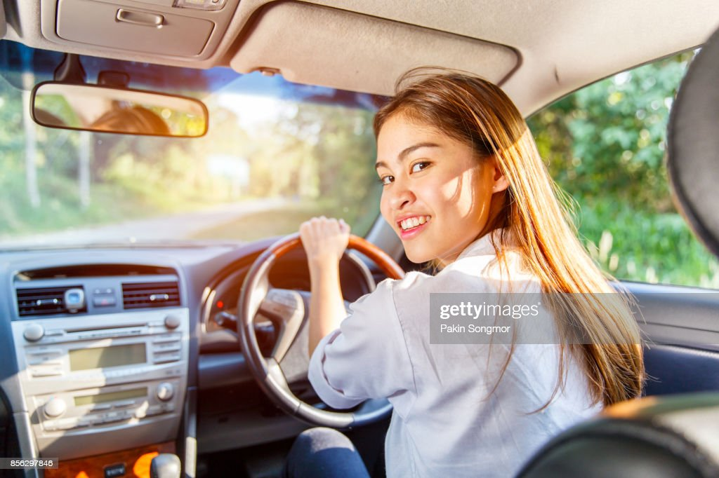 Young Asian Woman Driver Driving A Car On The Road In Countryside Stock -7801