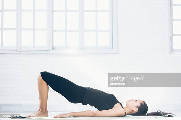 young asian woman exercising at home - pilates foto e immagini stock