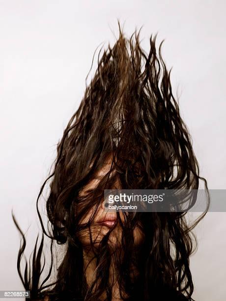 young asian woman flipping her hair in the air - verdecktes gesicht stock-fotos und bilder