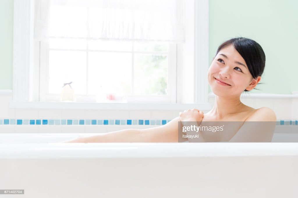 young asian woman in bathroom : Stock Photo