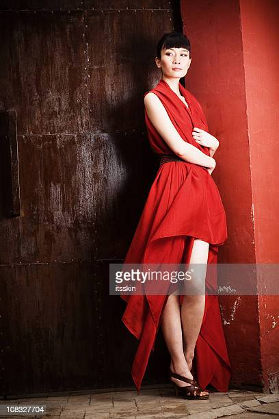 Young asian woman in red dress