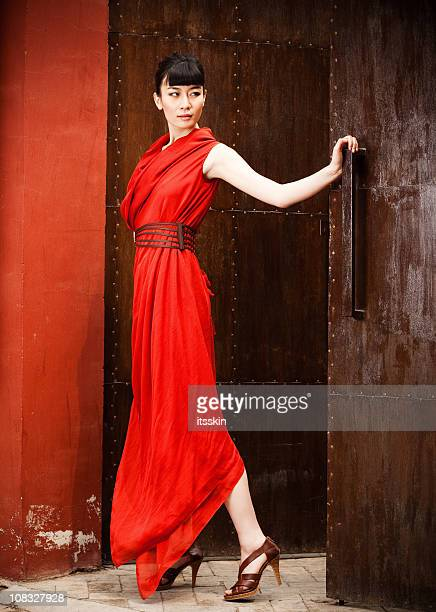 young asian woman in red dress - asian model stock photos and pictures