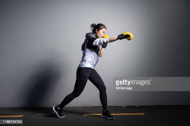 a young asian woman in sportswear is exercising - boxing stock pictures, royalty-free photos & images