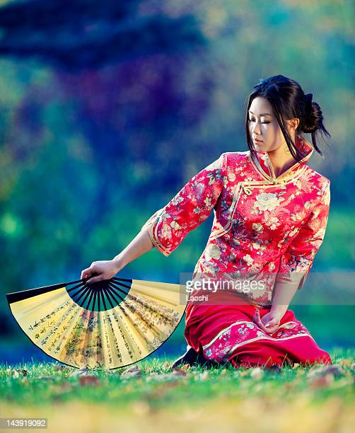 Young asian woman in the rays of autumn sun