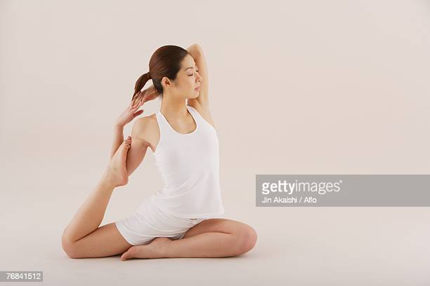 Young Asian woman in yoga  position