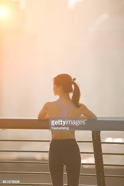 Young asian woman jog in the sunset at Shanghai city