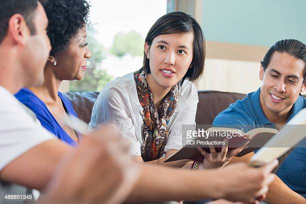 Young Asian woman leading discussion during bible study