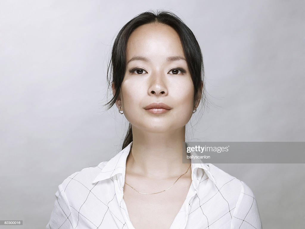 Young Asian woman, looking at camera. : Stock Photo