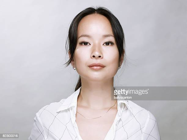 young asian woman, looking at camera. - blank expression stock pictures, royalty-free photos & images