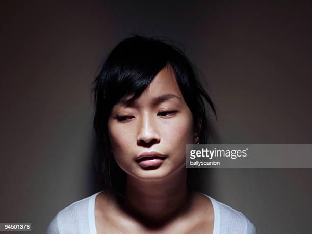Young Asian Woman Looking Sad.
