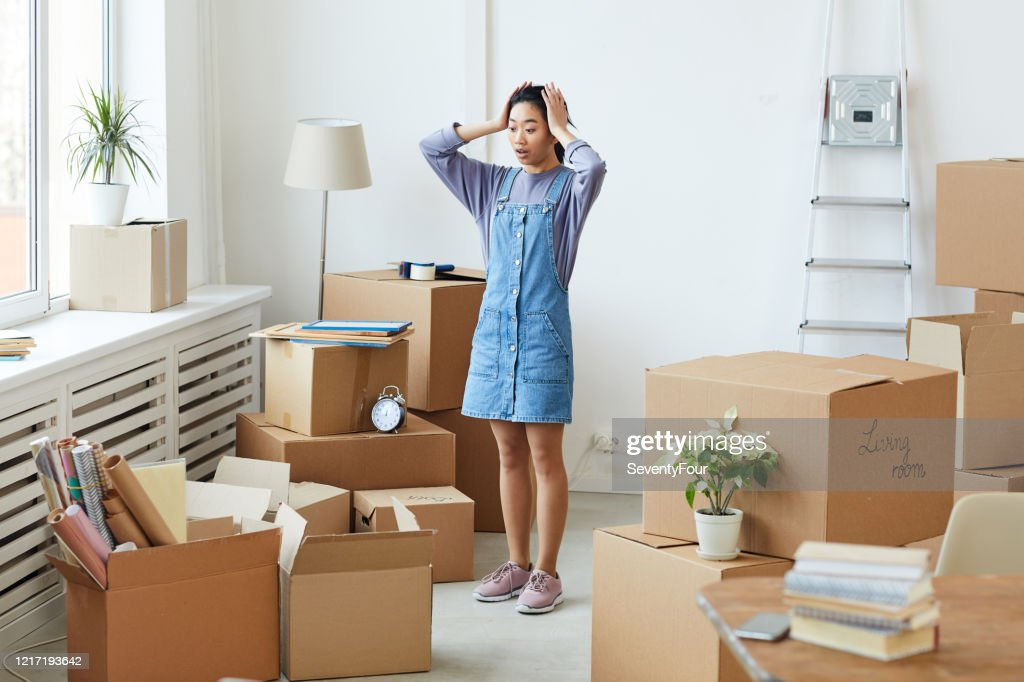 Young Asian Woman Panicking when Moving House : Stock Photo