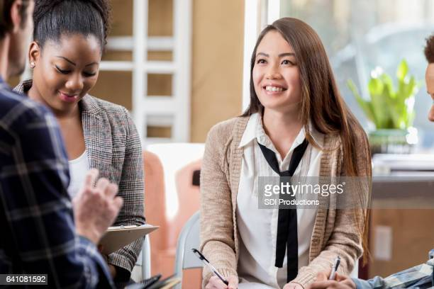 young asian woman participates in a discussion group - book club meeting stock pictures, royalty-free photos & images