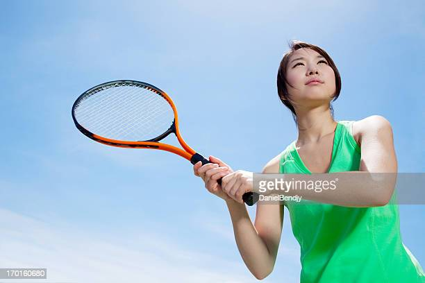Young Asian Woman Playing Tennis