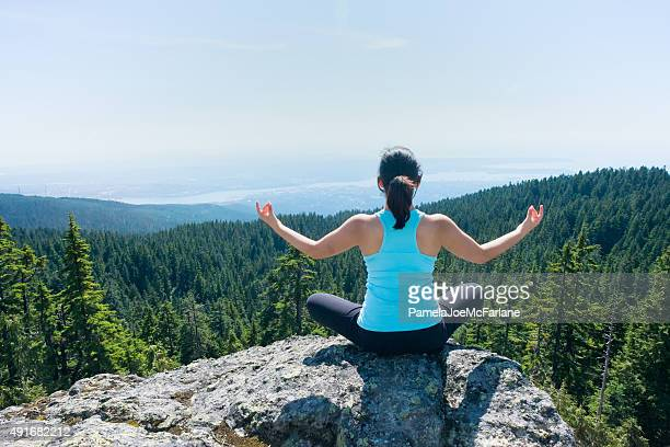 Young, Asian Woman Practising Yoga on Mountain Top with View
