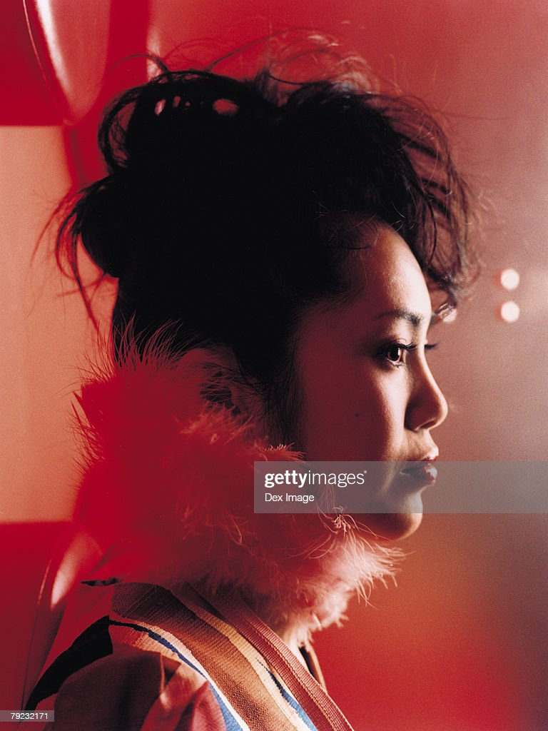 Young Asian woman, profile, close-up : Stock Photo