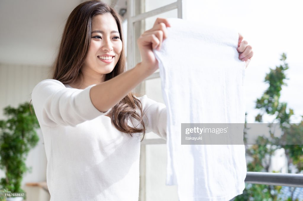 young asian woman relaxing in living room : Stock Photo