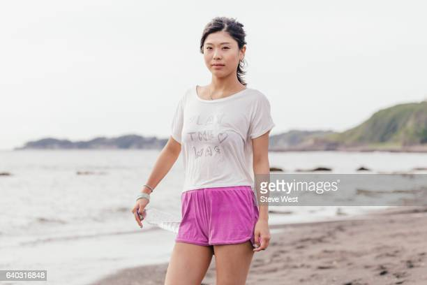 Young Asian Woman Resting After A Run On The Beach