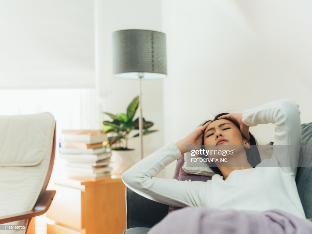 Young Asian woman sick at home : Stock Photo