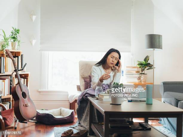 Young Asian woman sick at home