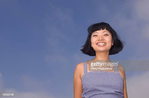 Young Asian woman smiling outdoors