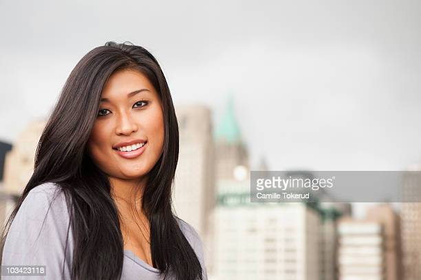 young asian woman smiling - newhealth stock photos and pictures