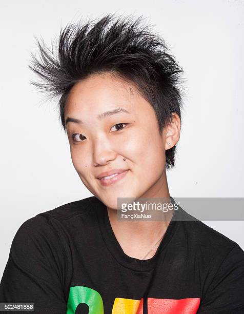 young asian woman smiling - new yorker building stock photos and pictures