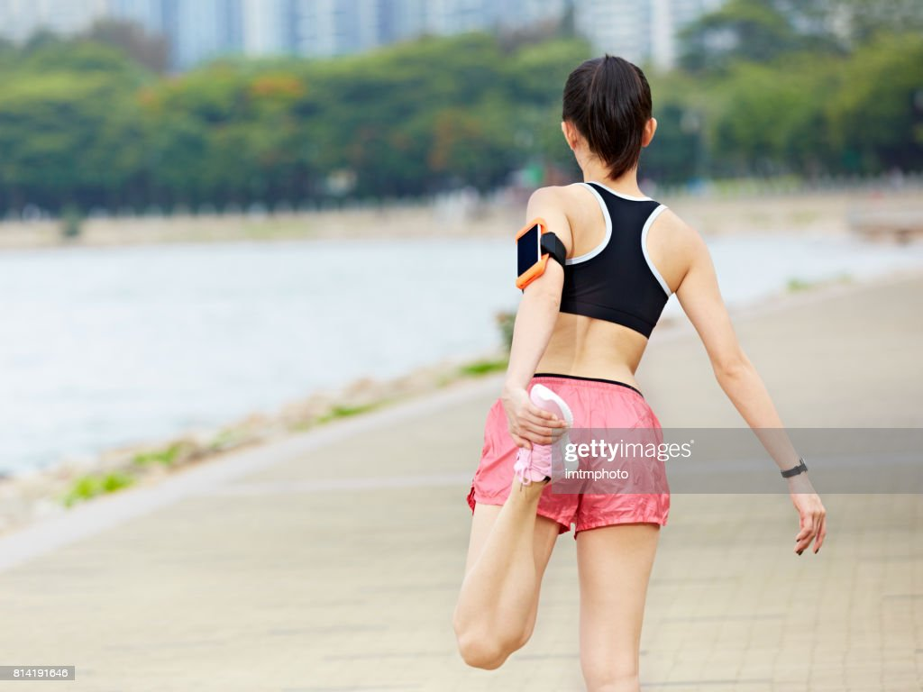 young asian woman stretching leg before exercise : Stock Photo