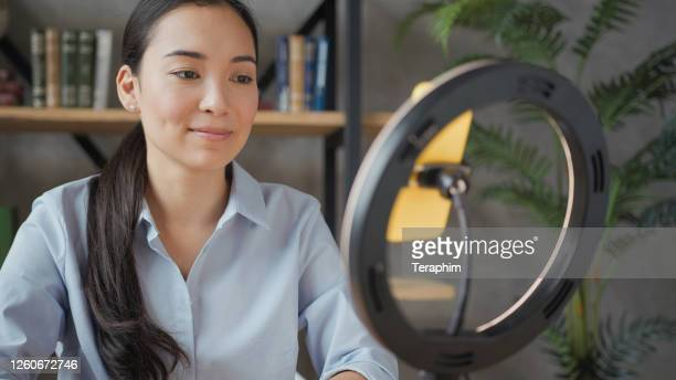 young asian woman teacher have videocall on smartphone - ring stock pictures, royalty-free photos & images