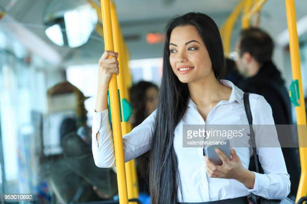 young asian woman traveling with a bus and using mobile phone - public transport stock pictures, royalty-free photos & images