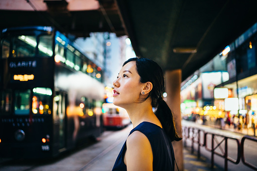 Young Asian woman traveller visiting and exploring busy city street in downtown Hong Kong - gettyimageskorea