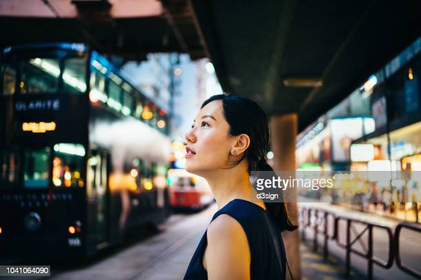young asian woman traveller visiting and exploring busy city street in downtown hong kong - curiosity stock photos and pictures