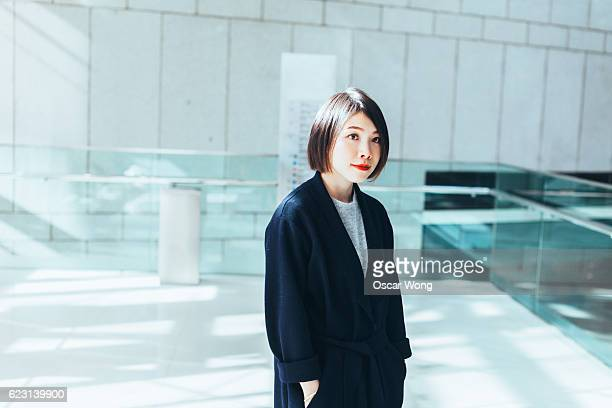 Young Asian woman walking in the lobby