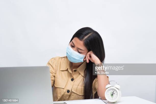 young asian woman wearing covid mask