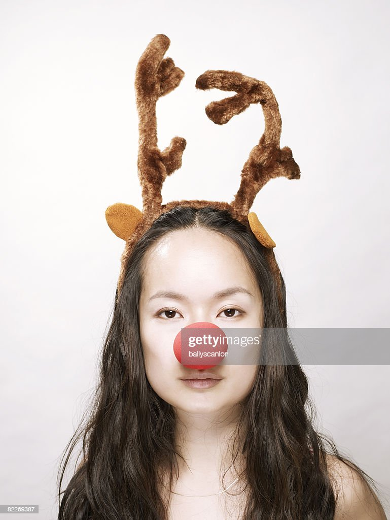 Young asian woman wearing antlers and nose  : Stock Photo