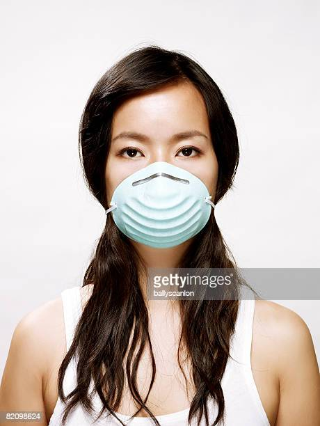 young asian woman wearing protective mask