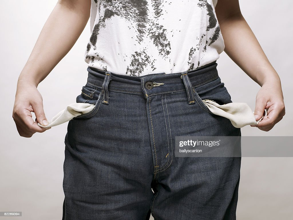 Young asian woman with empty pockets : Stock Photo